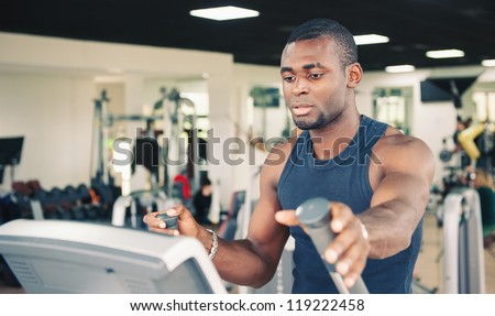 Young black man training in the gym.