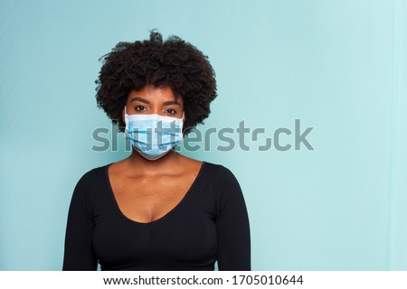 young black model wearing protective mask and black shirt and black power hair