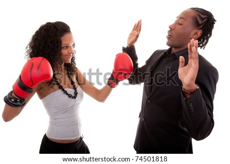 Young black woman and men boxing - stock photo