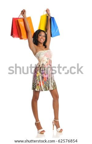 Young Black woman carrying colorful shopping bags isolated on white