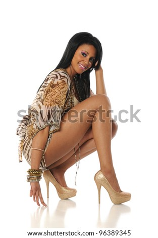 Young Black Woman Fashion model wearing a short dress and high heels - stock photo