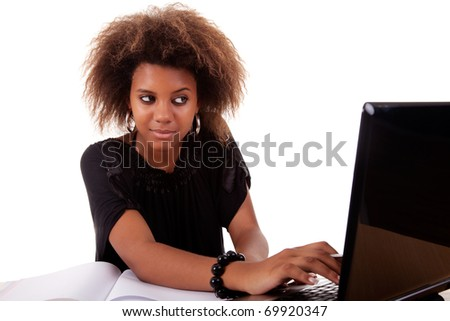 young black women working on desk looking to computer, isolated on white background. Studio shot.