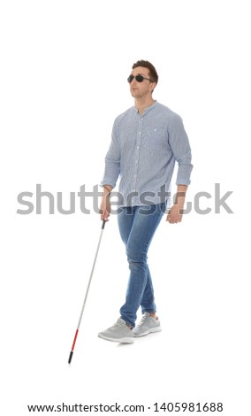 Young blind person with long cane walking on white background #1405981688