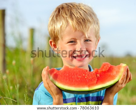 Young blond boy has healthy eating habits