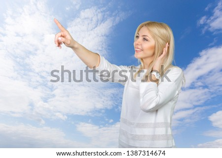 Young blond businesswoman pressing the touchscreen button #1387314674