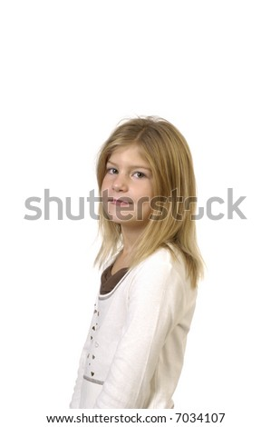 Young blond girl in studio looking at camera