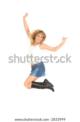 Young blond girl jumping of joy. White background.