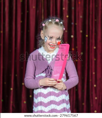 Girl Clowns Faces With Face Painted in Clown