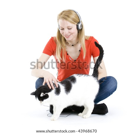 Young blond hair woman in headphones relaxing with her lovely cat