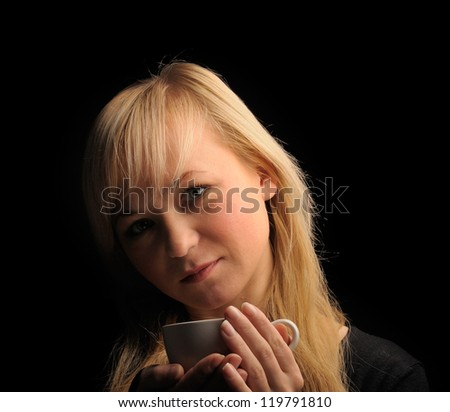 young blond hair woman with coffe  on a dark background. #119791810