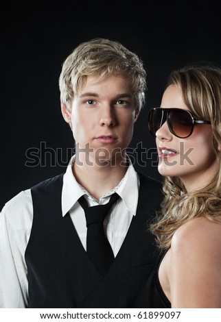 Young blond handsome man and pretty blond woman in sunglasses