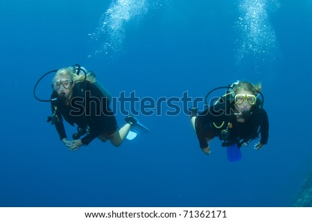 young blond scuba divers