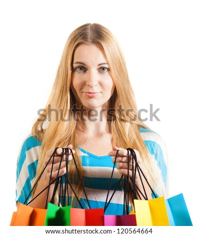 Young blond surprised woman after shopping
