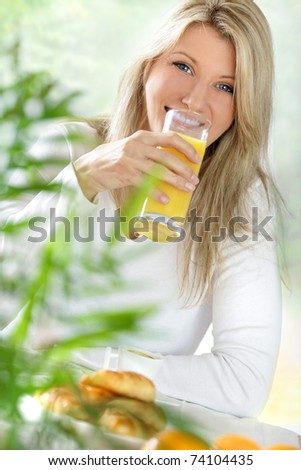 young blond woman at breackfast