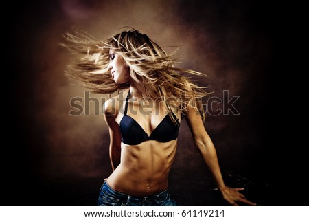 young blond  woman dancing  studio shot