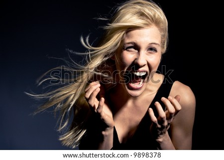 young blond woman screaming,  studio shot