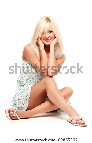 Young blond woman sitting on a floor