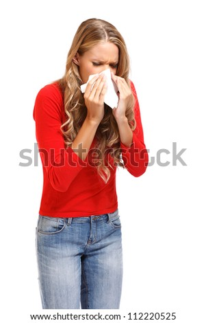 young blond woman sneezes isolated on white
