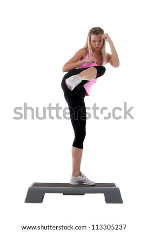 young blond woman stand on stepper and fight