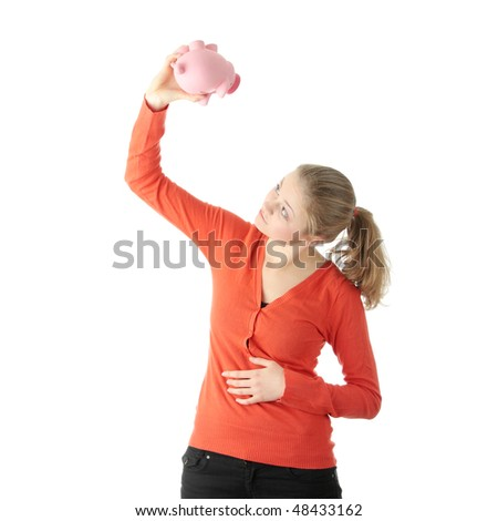 Young blond woman trying to get money from her piggy bank, isolated on white background