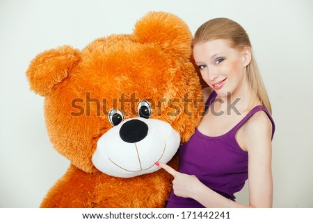young blond woman with a big teddy bear