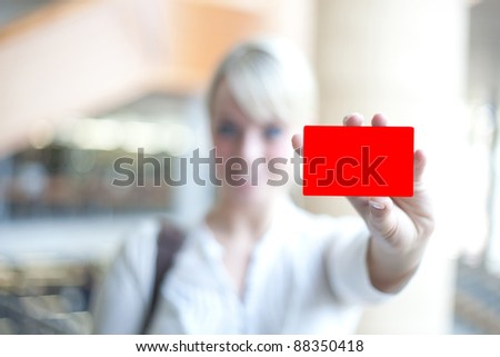 young blond woman with an identification card/woman with identification card