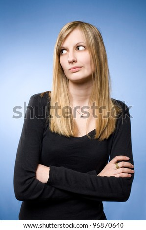 Young blond woman with funny facial expression showing denial, frowning.