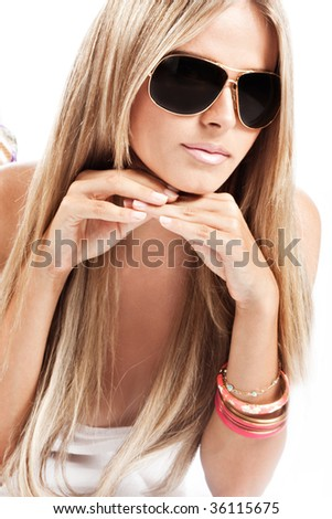 young blond woman with sunglases, studio white