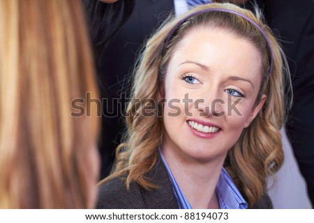 Young blonde attractive businesswoman, smile to her colleague