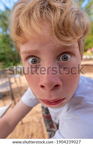 Young blonde boy making a silly face Stock photo ©