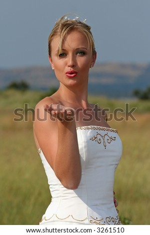 blowing kiss. blonde bride lowing kiss.