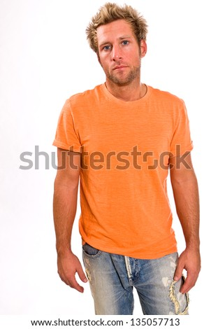 Young blonde Caucasian male in a bright orange t-shirt