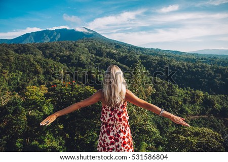 Young blonde caucasian woman traveling in the mountains, north of Bali, luxury vacation, explore and discover the world #531586804