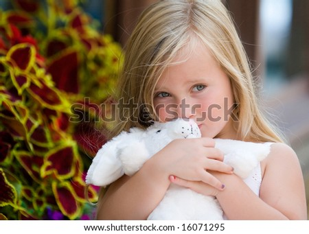 young blonde girl kissing bunny