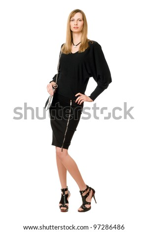Young blonde in black  in full length
