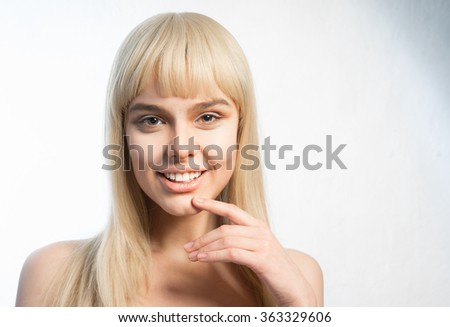 Stock Photo young blonde smiles