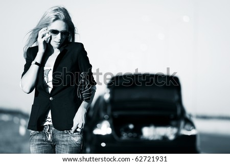 Young blonde with a broken car calling for help.