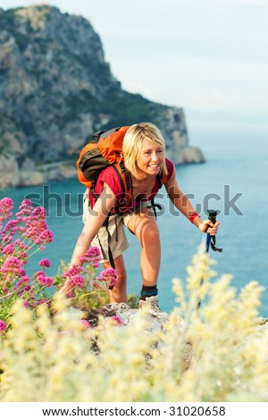 young blonde woman hiking and smiling. Copy space