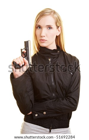 Young blonde woman holding a pistol in her hand