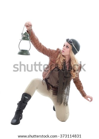 Stock Photo young blonde woman in a steampunk outfit, holding a gun, action hero pose. isolated on white background.