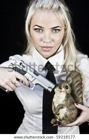 Young blonde woman in uniform with a gun