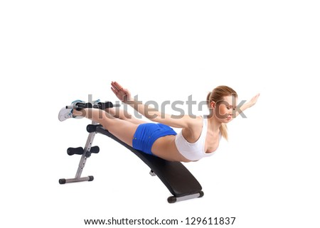 Young blonde woman on exerciser