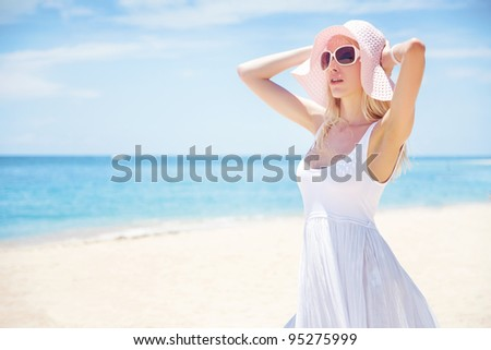 Young blonde woman on the beach, bali