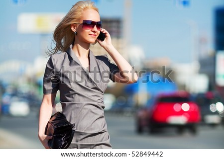 Young blonde woman on the phone.