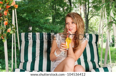Young blonde woman resting in lounge