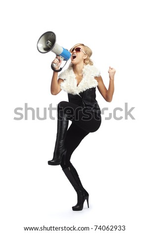 Young blonde woman  shouting through  megaphone