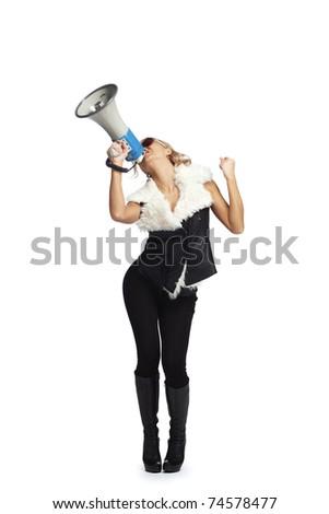 Young blonde woman  shouting through  megaphone