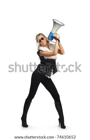 Young blonde woman  shouting through  megaphone - stock photo