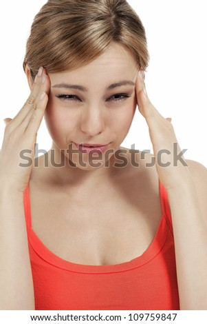 young blonde woman suffering extreme headache on white background