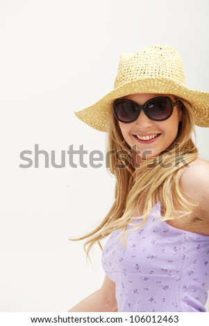 Young blonde woman wearing sun hat and sunglasses for summer.